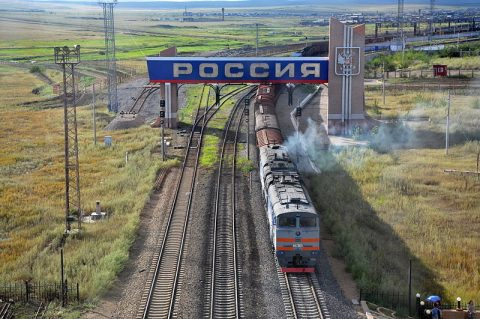 Russian diesel locomotive 2TE10M-2766 with freight train from Russia to China