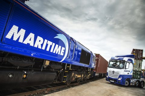 Maritime locomotive and Mercedes truck stand side by side