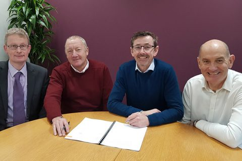 Image of WH David and VTG sign the deal, from left: Jonathan Hamer, Finance Director of WH Davis; Stewart Greenwood, MD of WH Davis; Nigel Day, Engineering Director, VTG Rail UK and Rob Brook, Head of VTG Rail UK at VTG's offices in Birmingham.